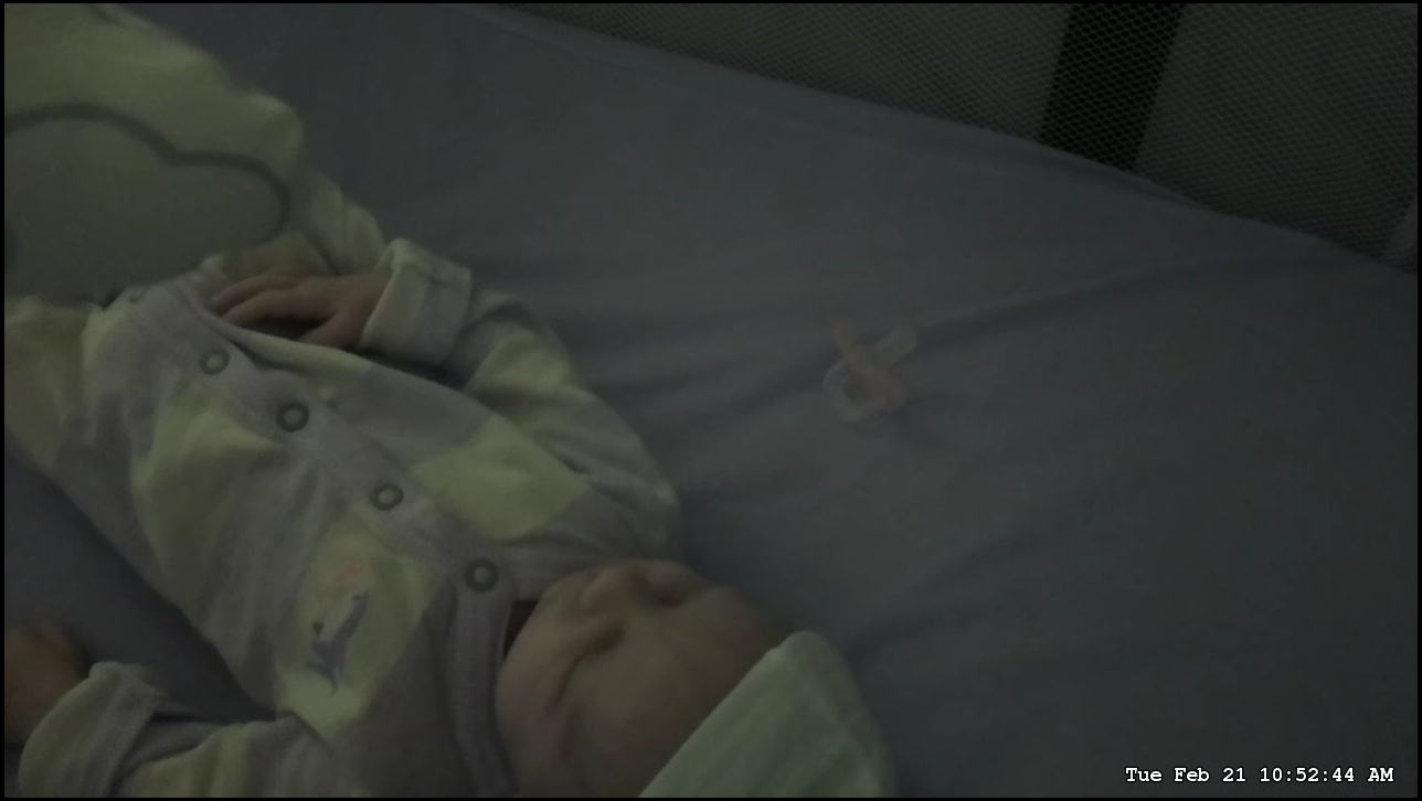 A picture of a baby in dim light